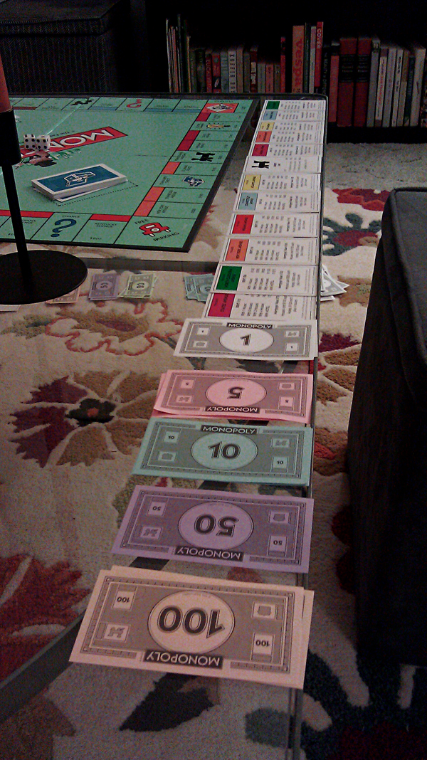 Playing one of our endless games of Monopoly.